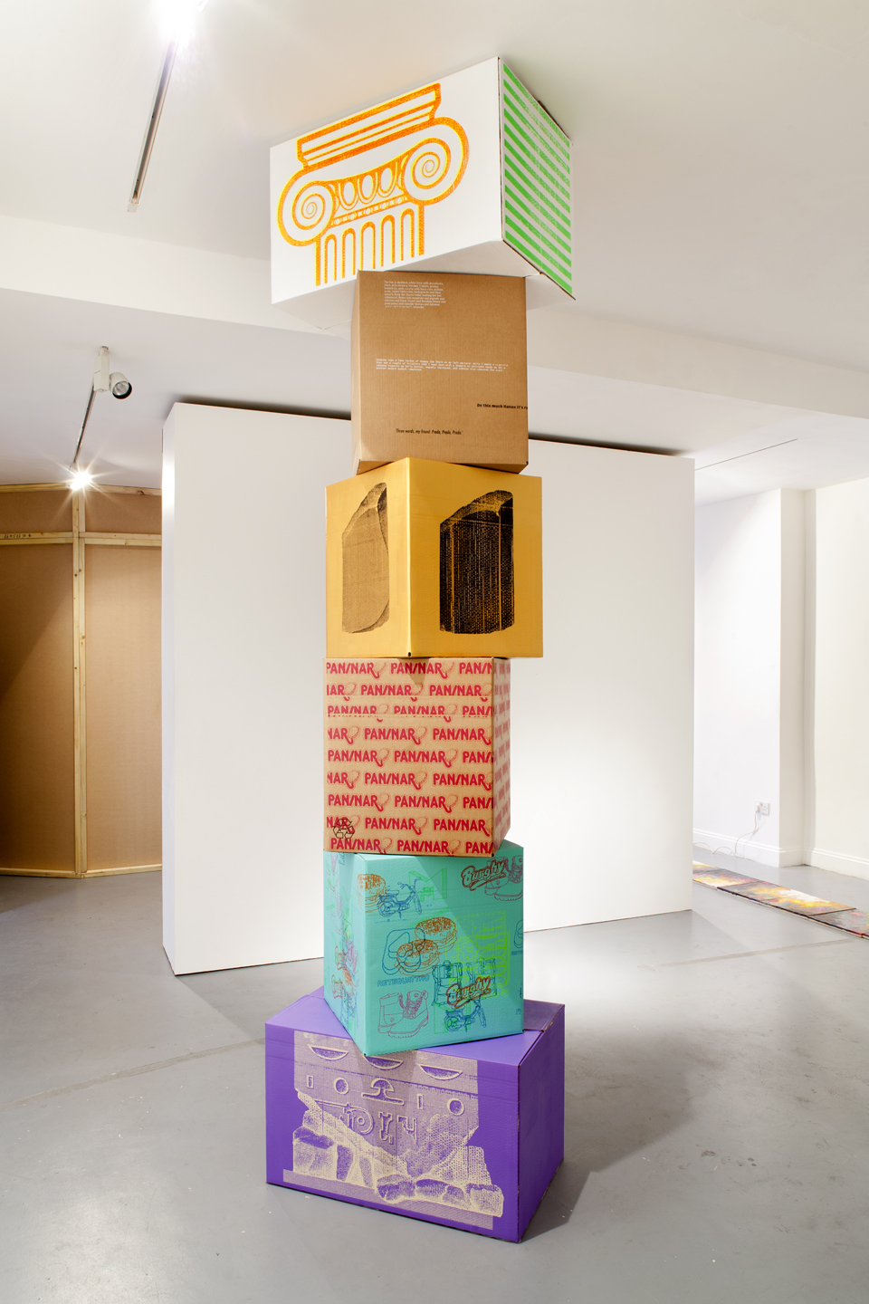 Pan-Stack, 2012 (part of Product Placement @ Angus Hughes Gallery). Screenprinting ink on cardboard, 300 x 75 x 75 cm. © Photograph Michele Panzeri.